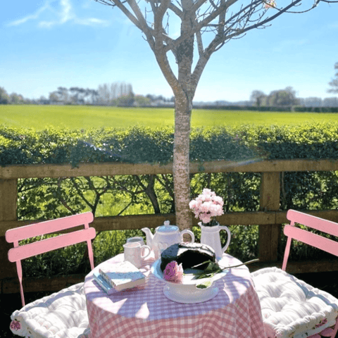 Outside in the garden there's a perfect spot for afternoon tea for two