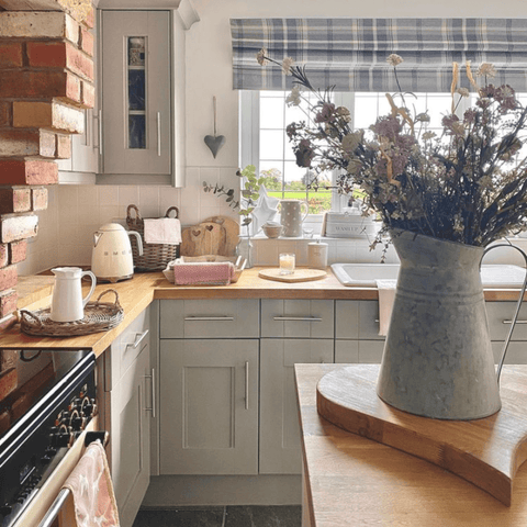 Exposed brickwork and traditional style furnishings create a gorgeous country cottage kitchen