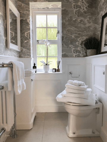 The bathroom is a true work of art and features Hampton and Astley irresistibly soft Egyptian cotton towels in pure white