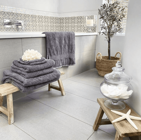 The bathroom features Hampton and Astley irresistibly soft Egyptian cotton towels in charcoal grey