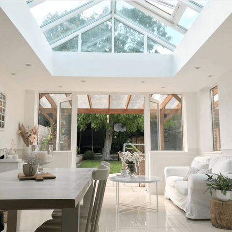 Bright whites and soft neutrals reflect the natural light in the stunning orangery style extension