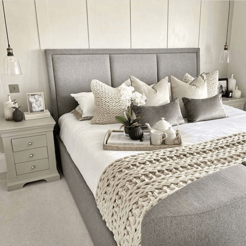 Kasia's master bedroom features Hampton and Astley long-staple cotton sateen bedding in pure white...