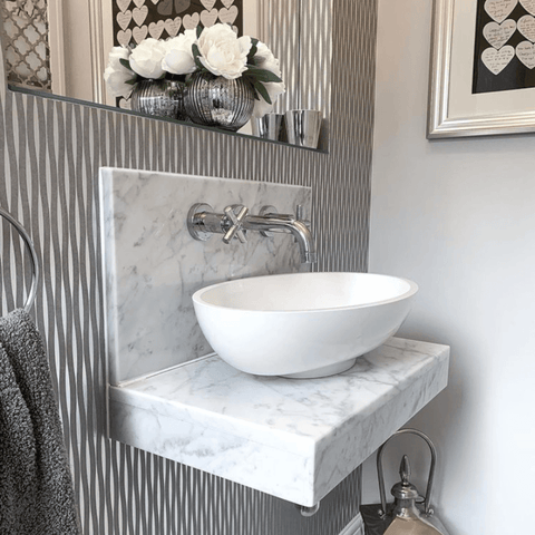How fabulous is the wallpaper in this little bathroom? We also love the hand-made picture featuring messages written by guests at India's wedding