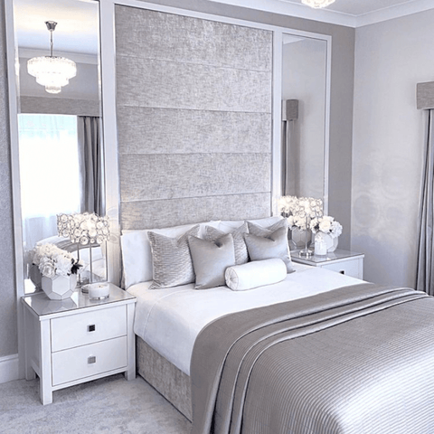 The upholstered headboard and bed base in this room are all India's own work, while the bed is made up with Hampton and Astley's luxury cotton sateen bedding in pure white