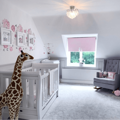 India has a passion for decorating nurseries, which is evident in the beautifully hand-crafted wall art, cot mobile and window blind in her daughter's room