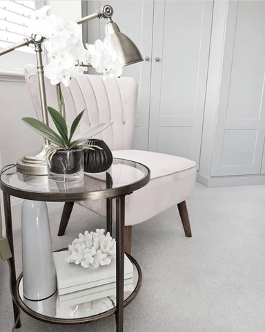 An elegant Caprice side table and delicate pink accent chair