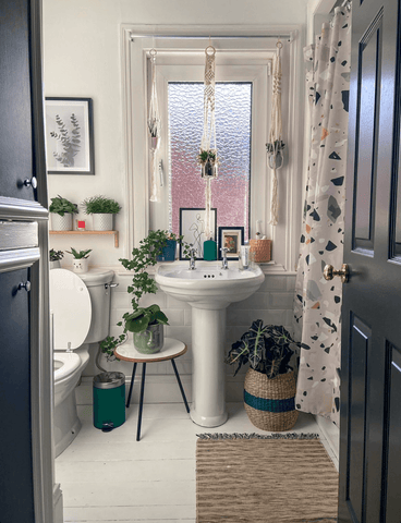 There's no denying Laura's love of houseplants, as the whole house embraces an indoor jungle vibe. The super cute bathroom is no exception