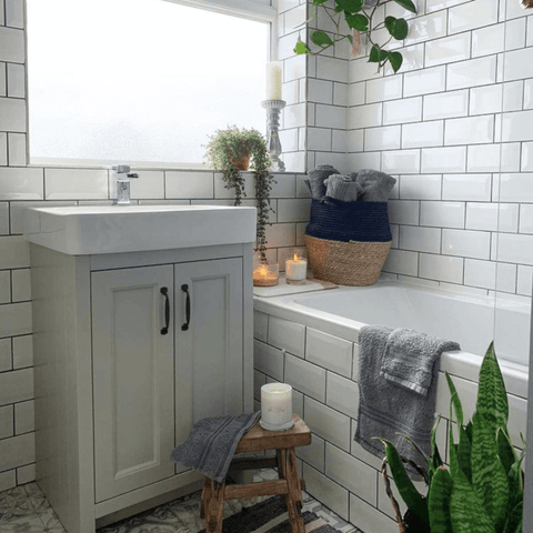 Upstairs, the metro tiled bathroom is home to more houseplants, as well as Hampton and Astley's irresistibly soft Egyptian cotton towels in subtle grey