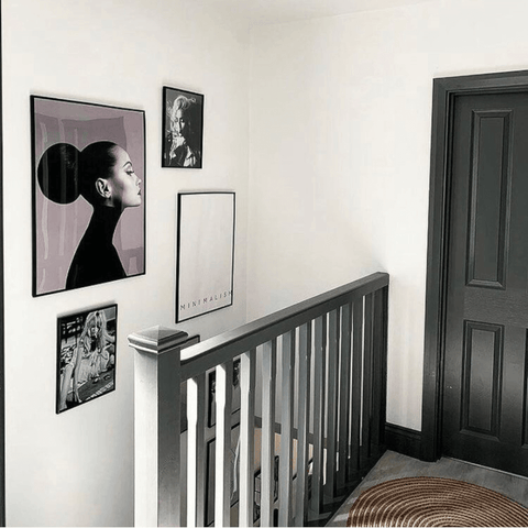 An eclectic collection of black and white prints are displayed in many of the rooms, including the minimalist monochrome stairway