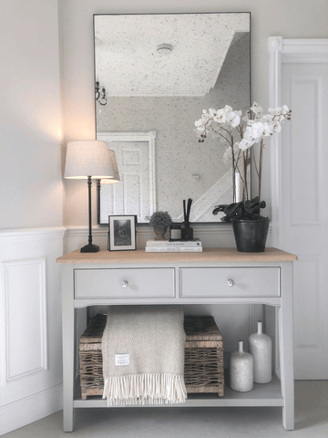 A beautifully accessorised console table, complete with a gorgeous white orchid, look as pretty as a picture