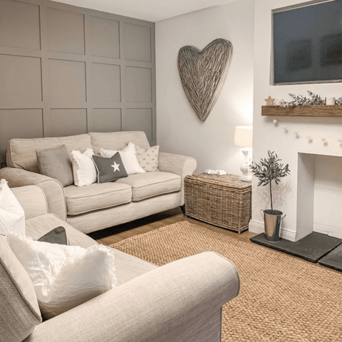 A feature wall in the super cosy, country cottage style lounge