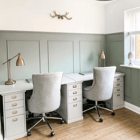 Soft green paneled walls in the office are lit up by a fabulous pair of matching brass desk lamps