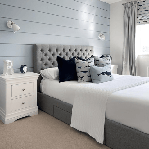 In the main bedroom, soft blue and grey furnishings complement the pure white Hampton and Astley Egyptian cotton sateen bedding