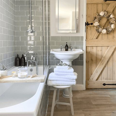 Classic country décor meets up with metro tiling in the bathroom, which features a stack of Hampton and Astley irresistibly soft Egyptian cotton towels in pure white