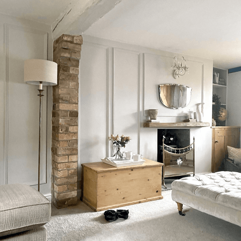 In the living room, exposed brickwork and unfinished wood furnishings look stunning against the soft neutral surfaces