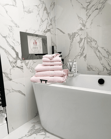 Add stack of blush pink towels