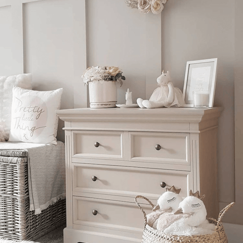 Just the subtlest hint of pink adds a delicate blush of colour to this super pretty bedroom that's fit for a princess