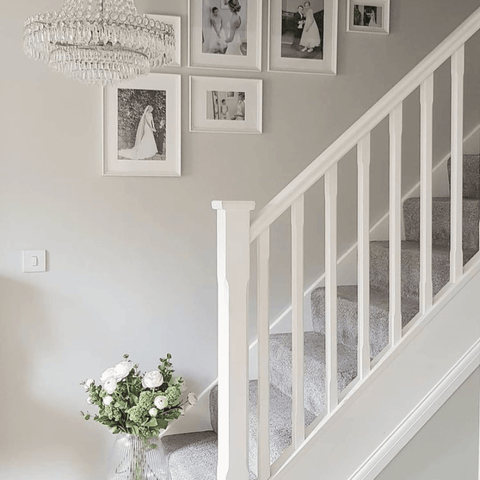 ...While an eye-catching series of black and white framed wedding pictures line the stairwell