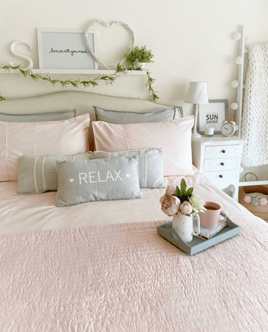 Pink is a great match for grey and so adding blush pink bedding is a good way to warm things up a touch