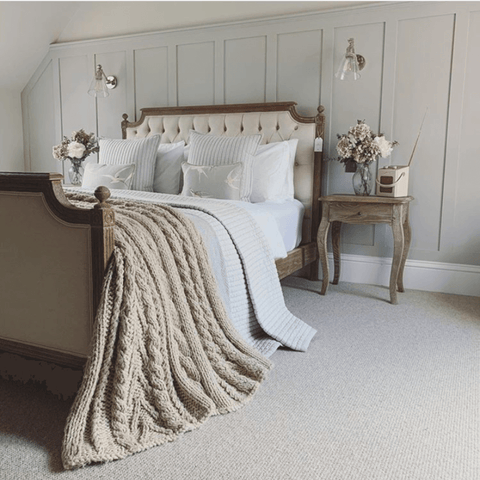 In the master bedroom, a fabulous French style Loire bed with a deep button back headboard features Hampton and Astley long-staple cotton sateen bedding in pure white