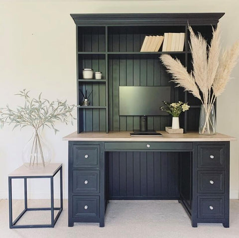 Finally, our favourite spot in the house is the study area, with its rather formidable bespoke black paneled desk, complete with ornamental pampas grass and a matching side table
