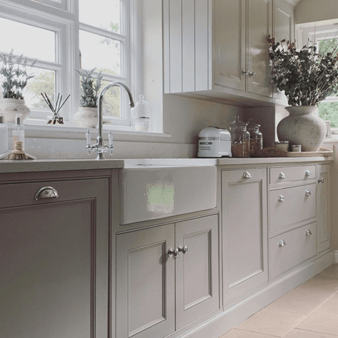 The modern country style kitchen is wonderfully light and spacious, with hand-made cabinets painted in Purbeck stone