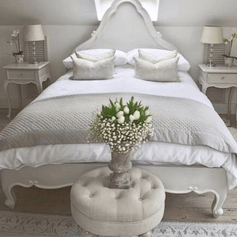 The master bedroom is a study in classic French country elegance and features Hampton and Astley long-staple cotton sateen bedding in pure white