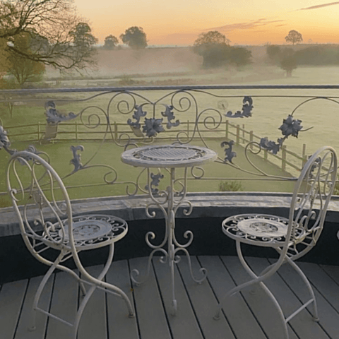 This view from the balcony is just breathtaking, made all the more beautiful by the bespoke wrought iron railings, which Amanda designed herself