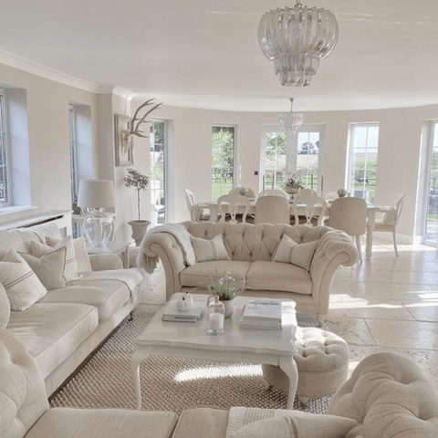 The extended living and dining area is wonderfully light and airy, thanks to the array of French windows complemented by white and neutral décor