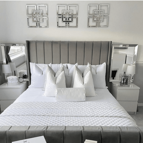 Chrome wall hangings and mirror frames complement the beautiful upholstered bed, made up with Hampton and Astley long-staple Egyptian cotton sateen bedding in pure white