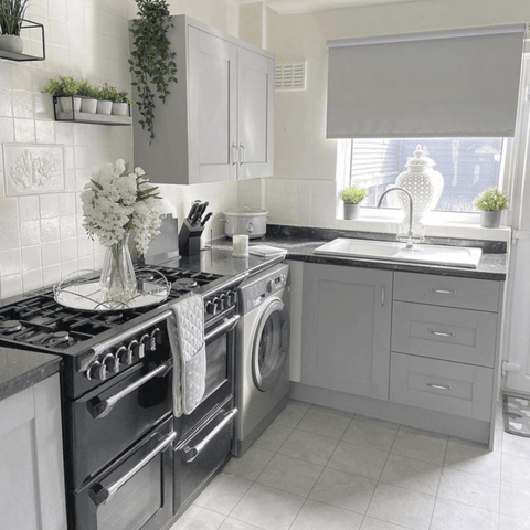 A coat of grey paint and a matching blind have completely transformed the upcycled kitchen