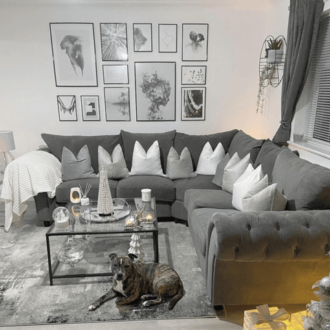 This giant corner sofa looks super inviting, although Chance the dog seems to prefer the matching grey rug