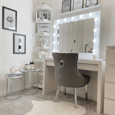 Upstairs, there's a dressing room with everything a girl could wish for, including a Hollywood mirror surrounded by plenty of designer inspiration