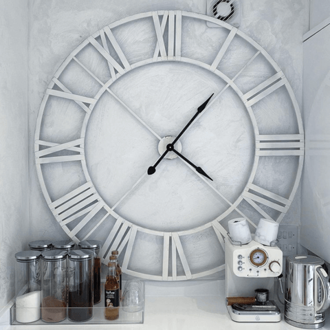 Victoria likes to keep her kitchen appliance free, so the coffee machine is hidden away in a recessed drinks station, that also houses a impressively huge wall clock