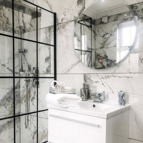 This look carries through to the elegant marble bathroom, which features a stack of Hampton and Astley indulgently thick Egyptian cotton towels