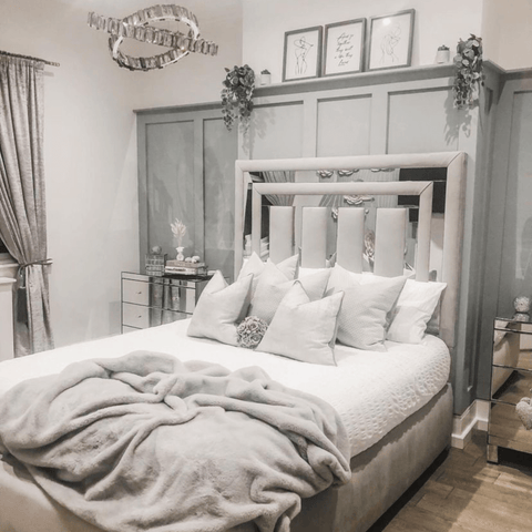 Soft grey and silver blend together beautifully in the stunning monochrome themed master bedroom.