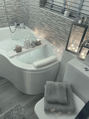 The ultra relaxing spa-style bathroom features Hampton & Astley Egyptian cotton towels