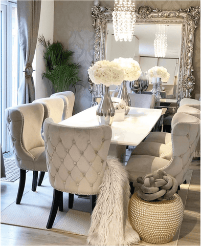 The fabulously opulent dining room can seat eight