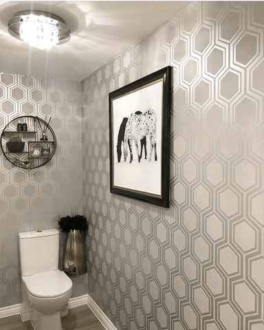 The smallest room in the house features sensational silver geometric patterned wallpaper