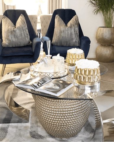 A glass-top coffee table adds the glam factor in the living area