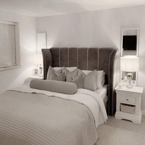 The luxurious master bedroom features Hampton and Astley's long-staple cotton sateen bedding in pure white