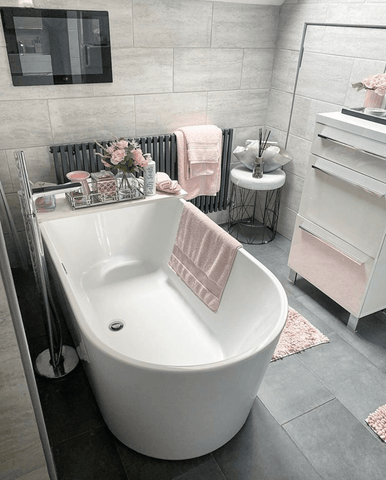 In a grey bathroom, you can't beat a stack of pretty blush pink towels