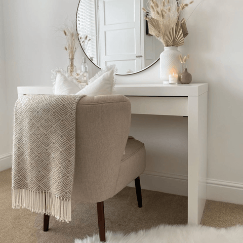 Along with an elegant dressing table and chair, overlooked by a classic circular mirror.