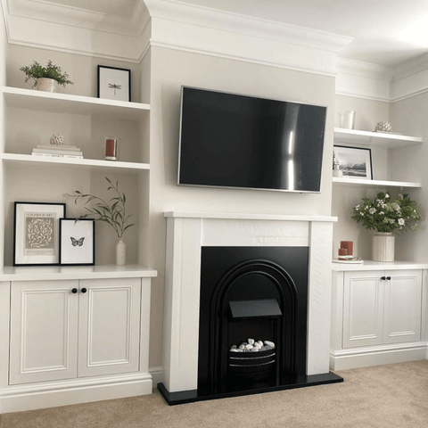 One of the most recent renovations is the addition of alcove shelving and matching cabinets around the fireplace downstairs