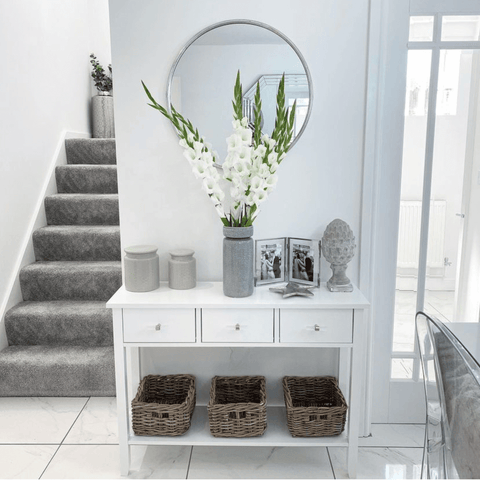 More flowers adorn the console table, which features the most fabulous white gladioli arrangement
