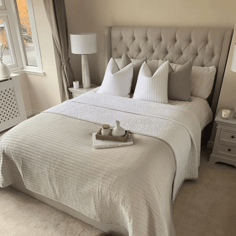 The master bedroom features an immaculately styled bed complete with Hampton and Astley long-staple cotton sateen bedding in pure white
