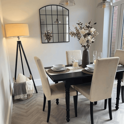 One of the most recent rooms to be renovated is the dining room, fitted with a stunning light oak herringbone floor and cleverly upcycled dining table and chairs