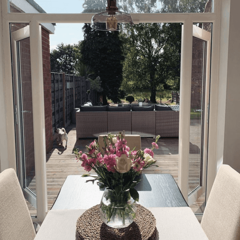 ...Which look out onto a lovely natural wooded garden with plenty of decking space for summer entertaining