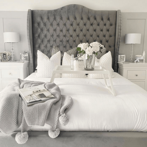 The super chic master bedroom features the most stunning upholstered grey bed as well as Hampton and Astley's Egyptian cotton sateen bedding in pure white.
