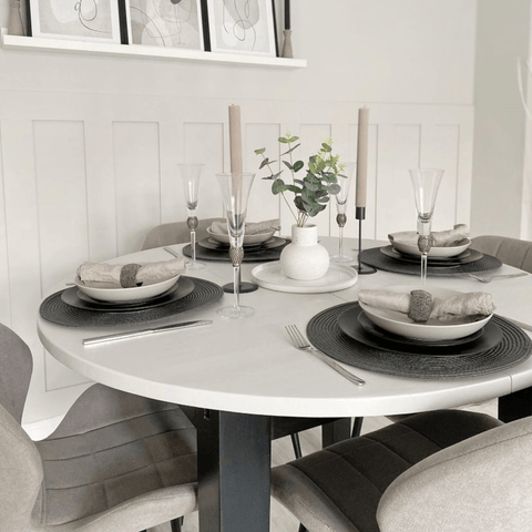 DIY paneling and and an upcycled table in the dining area.